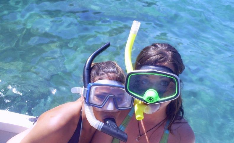 Snorkeling off the coast of Santa Teresa, Costa Rica on our way to Isla Tortuga